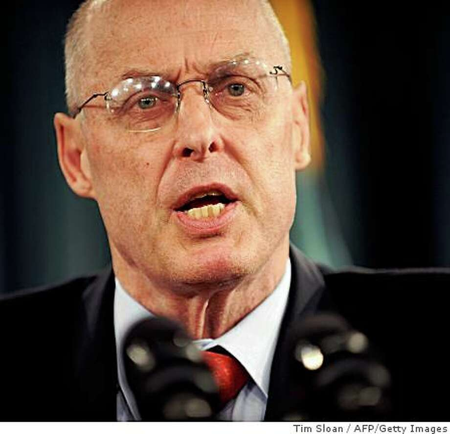 US Secretary of the Treasury Henry Paulson speaks at a press conference on October 8, 2008 in Washington, DC. Paulson called Wednesday for a special meeting of the Group of 20 advanced and emerging countries to discuss ways to combat the financial crisis.        AFP PHOTO / TIM SLOAN (Photo credit should read TIM SLOAN/AFP/Getty Images) Photo: Tim Sloan, AFP/Getty Images