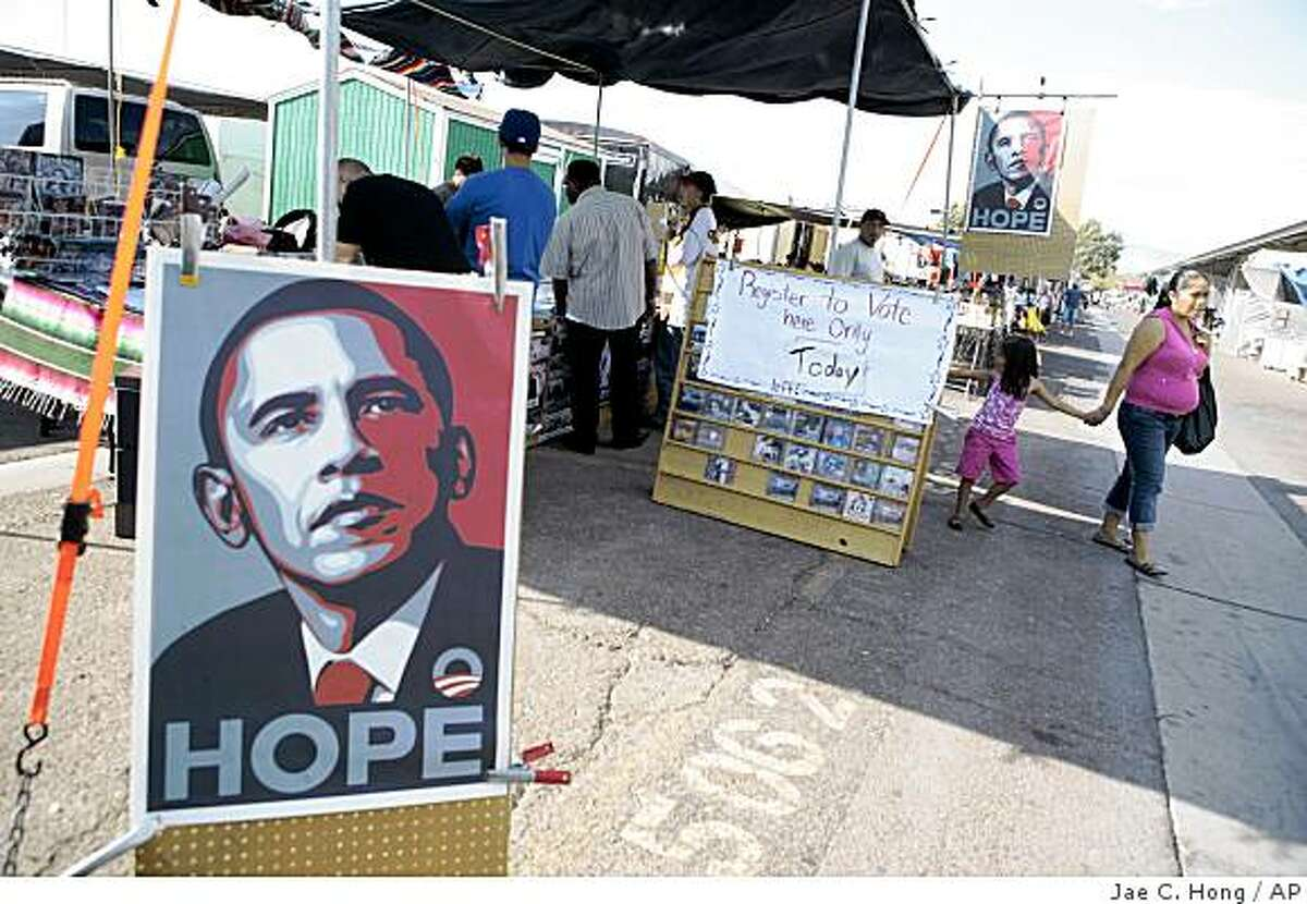 Posters supporting Democratic presidential candidate Sen. Barack Obama D-Ill., are seen at a outdoor swap meet in Las Vegas, Saturday, Oct. 4, 2008. The man who once risked his career on an immigration reform bill that was embraced by Hispanics is now struggling to win these same voters, and falling perilously below the level of support that helped lift President Bush to the White House. The candidate who won nearly 70 percent of Hispanic voters in his last bid for Senate in border-state Arizona is watching a first-term Illinois senator run away with those voters. (AP Photo/Jae C. Hong)