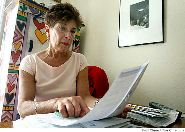 Fran Quittel reviews statements from her savings and checking accounts at IndyMac Bank in Emeryville, Calif., on Friday, Sept. 26, 2008. Quittel was among the many account holders that had to recover their money through the FDIC after IndyMac folded in July. Photo: Paul Chinn, The Chronicle