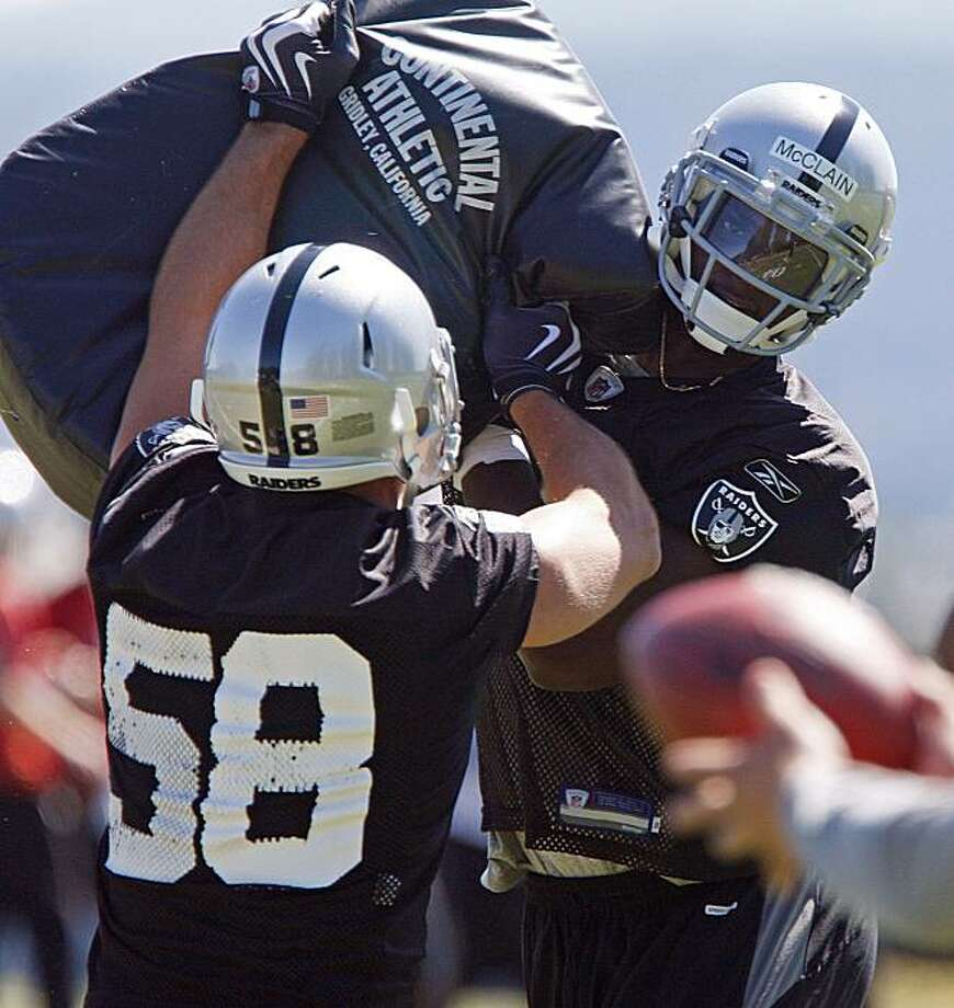 Oakland Raiders' Rolando McClain, right, and Slade Norris (58) work on a drill during a rookie football mini-camp drill Friday, April 30, 2010, in Alameda, Calif. Photo: Ben Margot, AP