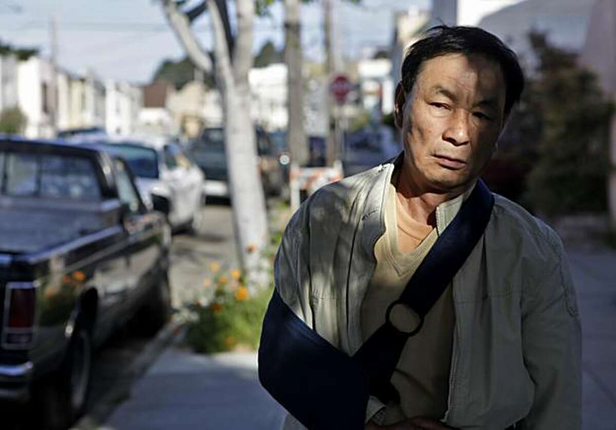 Rongshi Chen, 64 years old, stands in front of the house on Arleta, Saturday May 1, 2010, where he was beaten over six months ago in San Francisco, Calif. On September 12, 2009, Rongshi Chen was robbed and thrown onto the concrete dislocating his shoulder while walking to work in Visitacion Valley. Their has been no arrest in the attack.