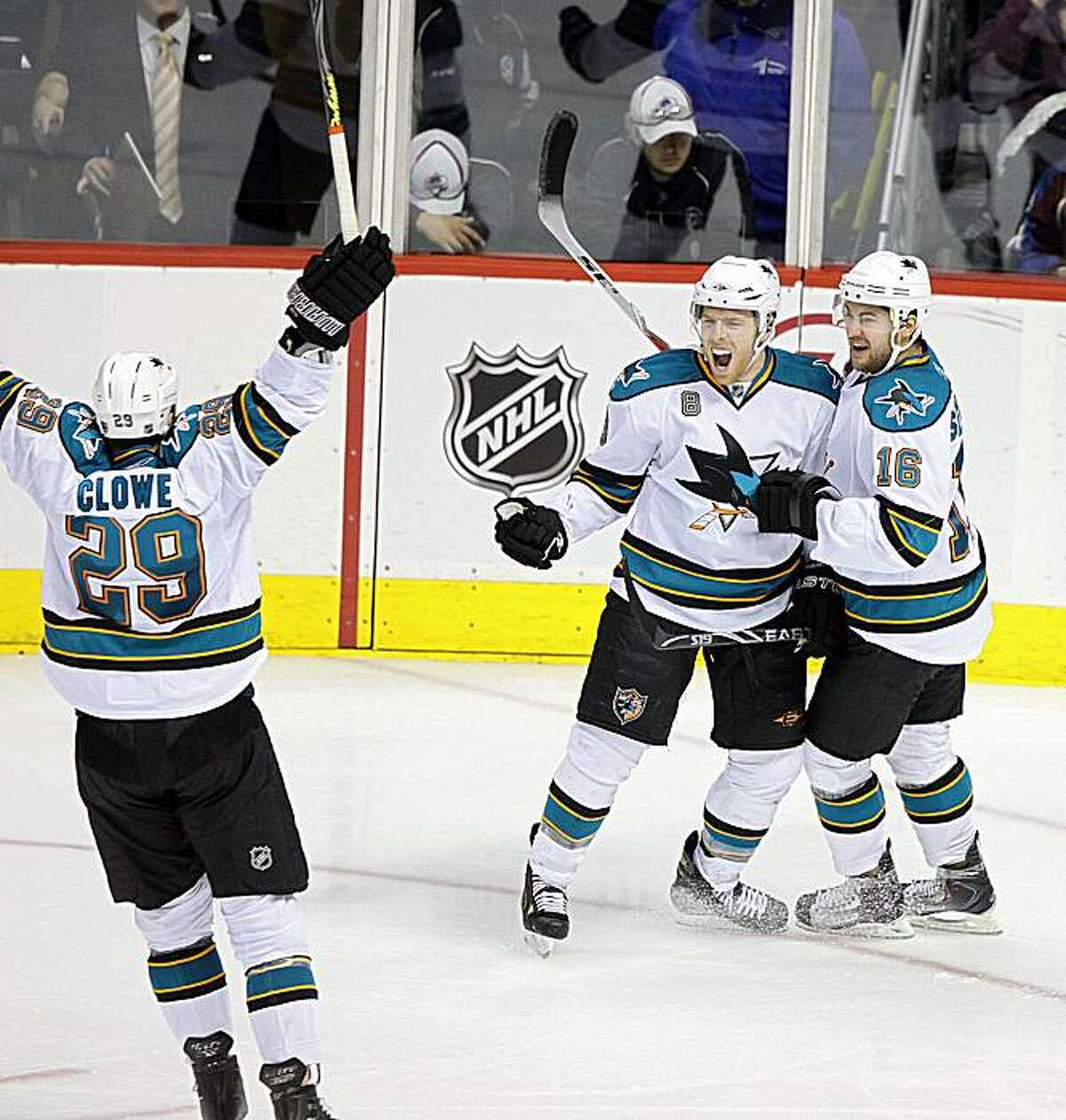 DENVER, CO - APRIL 24 : Joe Pavelski #8 of the San Jose Sharks celebrates with teammates Devin Setoguchi #16 and Ryane Clowe #29 after Pavelski scored what would turn out to be the game winner in the third period of Game Six of the Western Conference Quarterfinals during the 2010 NHL Stanley Cup Playoffs at the Pepsi Center on April 24, 2010 in Denver, Colorado. The Sharks won the game 5-2 and took the series 4-2.