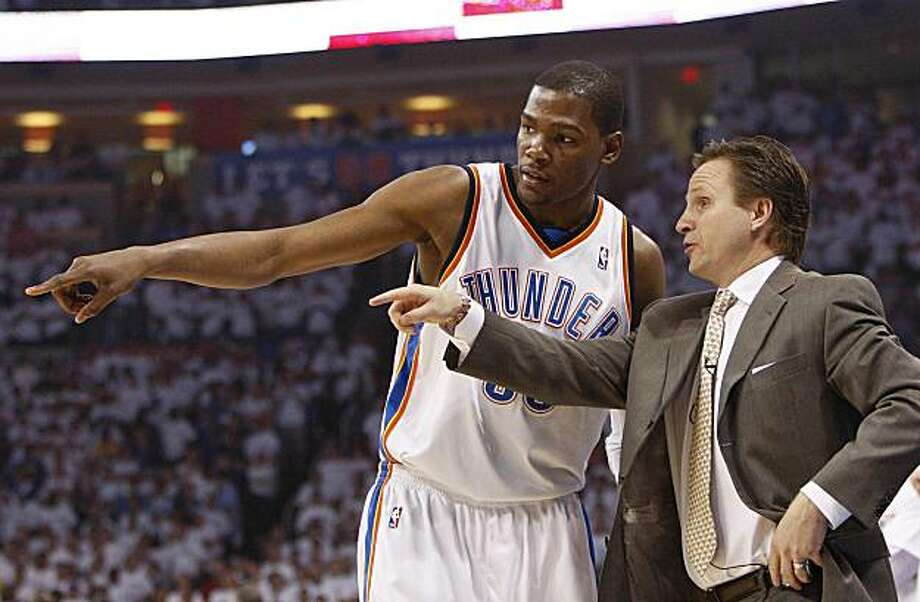 Oklahoma City Thunder Head Coach Scott Brooks, right, coaches Kevin Durant, left, in the first quarter of Game 4 of a first-round NBA basketball playoff series in Oklahoma City, Saturday, April 24, 2010. Photo: Alonzo Adams, AP