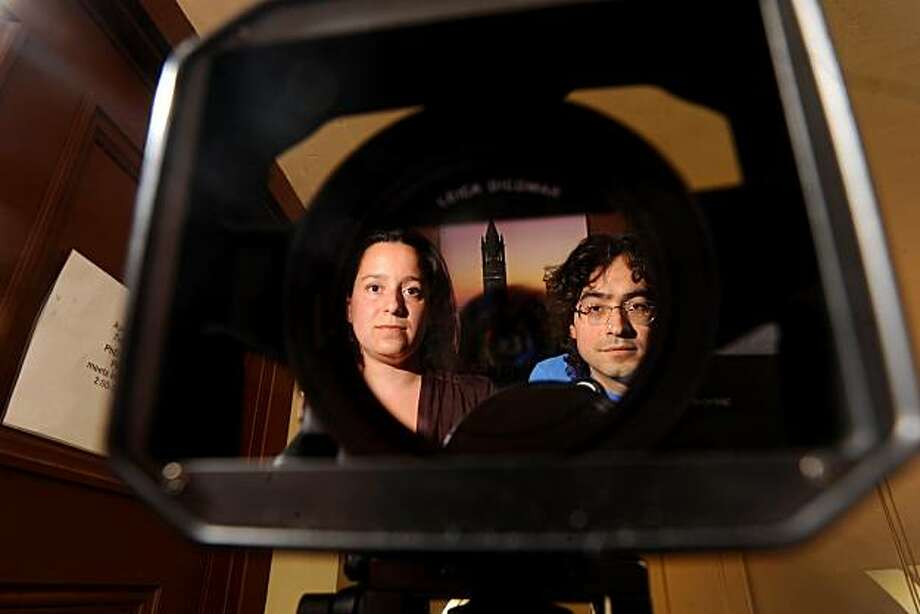 "Roberto Hernandez and Layda Negrete, filmmakers and UC Berkeley public policy doctoral students, are reflected in one of the cameras used to film ""Presumed Guilty,"" on Tuesday, April 6, 2010, in Berkeley, Calif. Photo: Noah Berger, Special To The Chronicle"