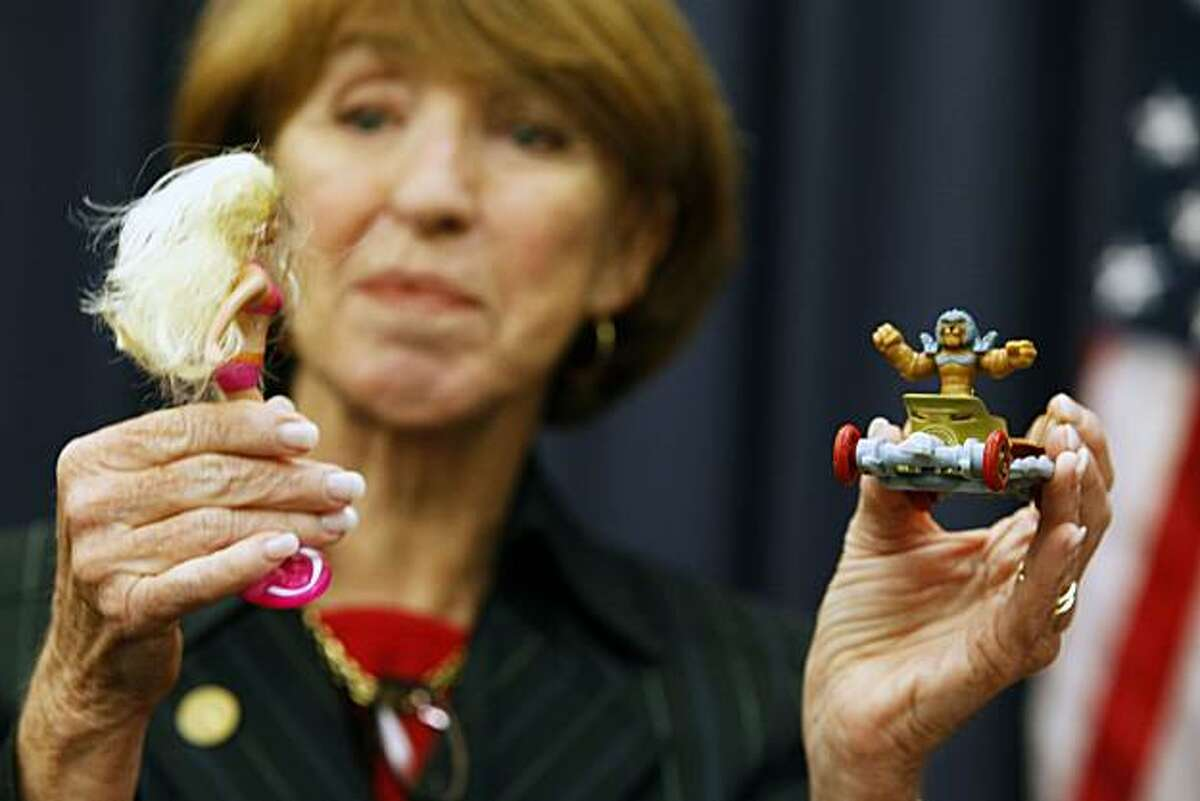 Liz Kniss, a member of the Santa Clara County Board of Supervisors, holds up toys purchased Tuesday at fast food restaurants in San Jose.