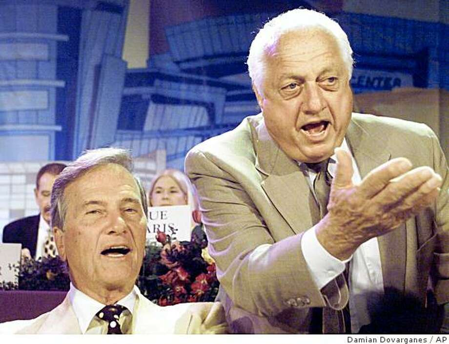 Entertainer Pat Boone, left, and Los Angeles Dodgers Senior Vice President Tommy Lasorda react during the Central City Association 8th Annual Treasures of Los Angeles Luncheon Thursday, April 25, 2002. Photo: Damian Dovarganes, AP