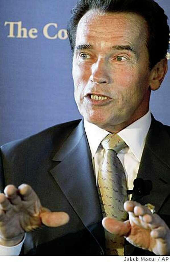 California Governor Arnold Schwarzenegger speaks on the state's plan to transition to a clean energy economy at the Commonwealth Club in San Francisco on Friday, Sept. 26, 2008. Governor Schwarzenegger appears on the second anniversary of his signing of the Global Warming Solutions Act. (AP Photo/Jakub Mosur) Photo: Jakub Mosur, AP