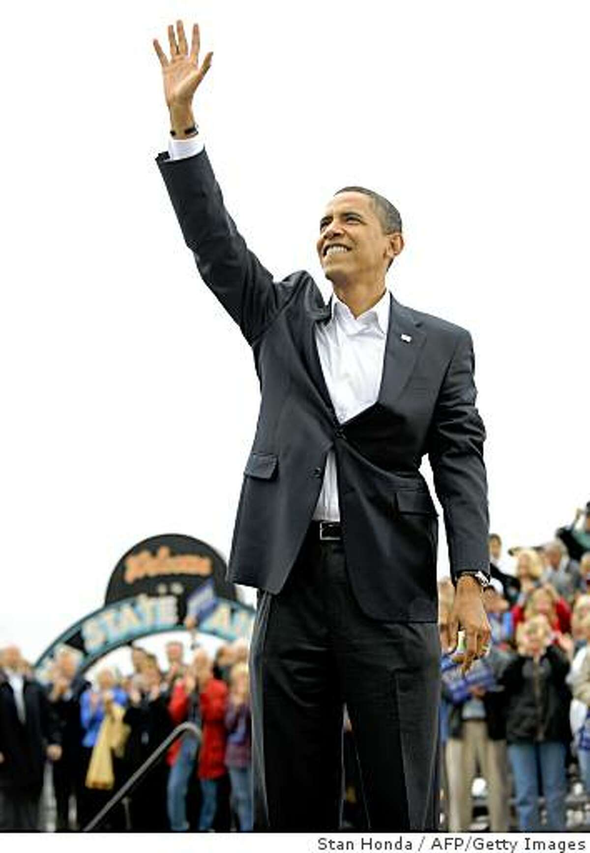US Democratic presidential candidate Illinois Senator Barack Obama waves to the crowd at a rally October 8, 2008 at the Indiana State Fairgrounds in Indianapolis, Indiana. AFP PHOTO/Stan HONDA (Photo credit should read STAN HONDA/AFP/Getty Images)