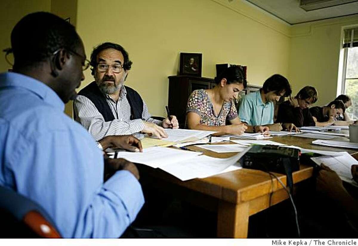 With the help of U.C. Berkeley professor, Larry Hyman, (beard) Graduate student, Simon Nsielanga Tukumu (lft) pronounces words from is native language, Nzadi, during an undergraduate Linguistics class on Wednesday Sept. 10, 2008 in Berkeley,Calif.
