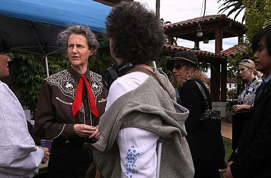 Temple Grandin (left), 62 years old, is autistic and tells her story while lecturing about early therapies during a benefit for Matrix, a nonprofit which helps families with special needs children, in Novato, Calif., on Monday, April 19, 2010.  She is talking with parents and others after her lecture.  Also an animal scientist, her work designing cattle pens and corrals revolutionized slaughterhouses in the 1970s and '80s. Photo: Liz Hafalia, The Chronicle