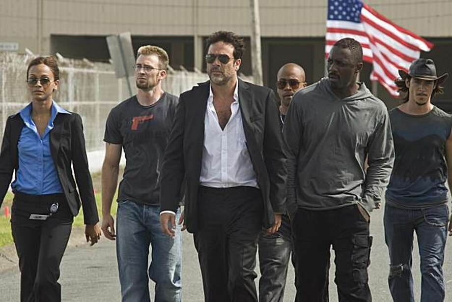 L-r: ZOE SALDANA as Aisha, CHRIS EVANS as Jensen, JEFFREY DEAN MORGAN as Clay, COLUMBUS SHORT as Pooch, IDRIS ELBA as Roque and OSCAR JAENADA as Cougar in THE LOSERS Photo: John Bramley, Warner Bros. Pictures.