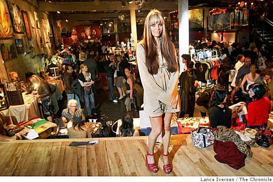 """Chillin"" founder Irene Hernandez-Feiks poses for a photo among her guests. The tenth annual hipster art-fashion-networking party called ""Chillin' "" took place at the Mezzanine Night club, at 444 Jessie Street in San Francisco, Calif, Saturday May 10, 2008. By Lance Iversen / San Francisco Chronicle. Photo: Lance Iversen, The Chronicle"