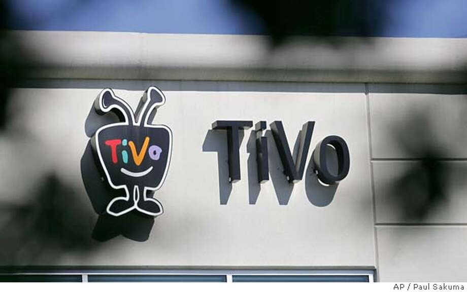 An exterior view of TiVo headquarters is shown in Alviso, Calif., Tuesday, May 23, 2006. TiVo Inc., a pioneer of digital video recording, reports its first-quarter results after the bell. Analysts are expecting a loss of 19 cents per share, including stock option costs, on sales of $50.6 million. (AP Photo/Paul Sakuma)  Ran on: 05-25-2006  TiVo Inc. of Alviso reported a loss of 13 cents per share, blaming the poor showing on legal costs and expenses for stock options. Photo: PAUL SAKUMA
