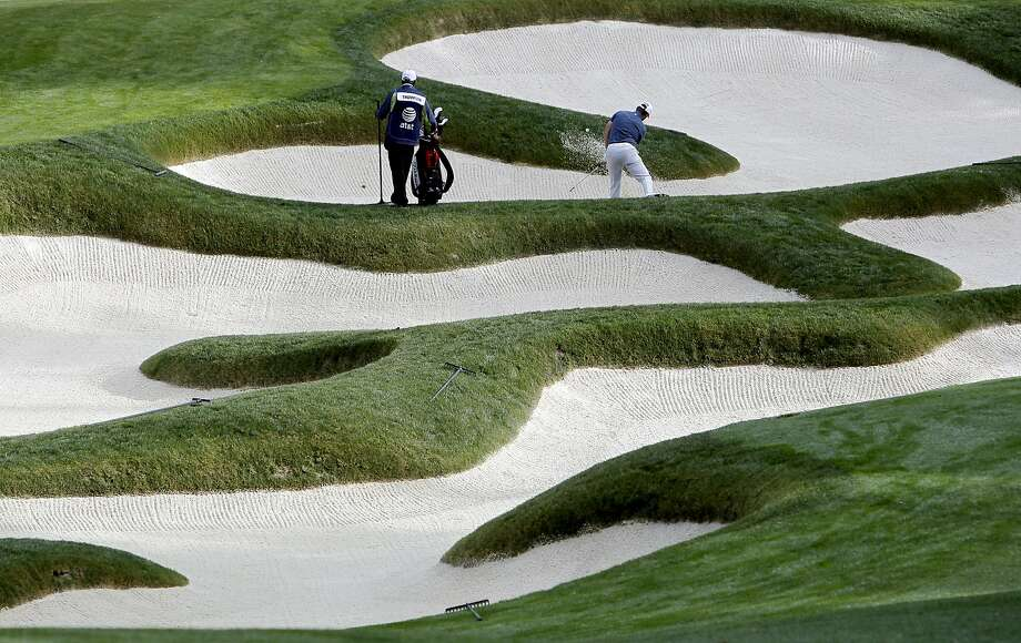 Kyle Thompson hits out of the green side bunker on the 11th hole at Spyglass Hill, during second round action at the 2012 AT&T Pebble Beach National Pro-Am Golf Tournament, in Pebble Beach, Ca. on Friday Feb. 10, 2012. Photo: Michael Macor, SFC