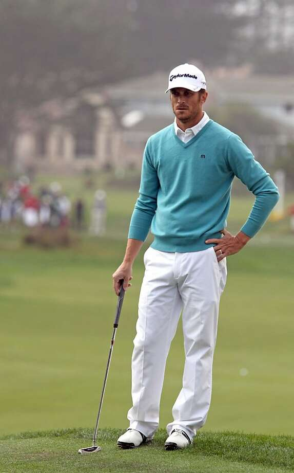 Actor Oliver Hudson studies his putt on the seventh green at the Monterey Peninsula Country Club during the second round of the AT&T Pebble Beach National Pro-Am golf tournament in Pebble Beach, Calif., Friday, February 10, 2012. Photo: Lance Iversen, The Chronicle