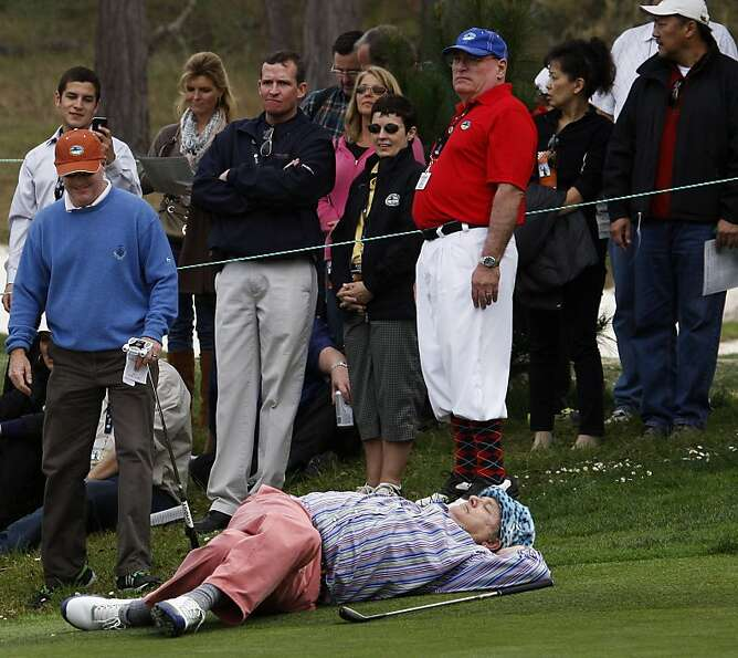 After complaining that play was slow actor-comedian Bill Murray takes a break on the third hole at t