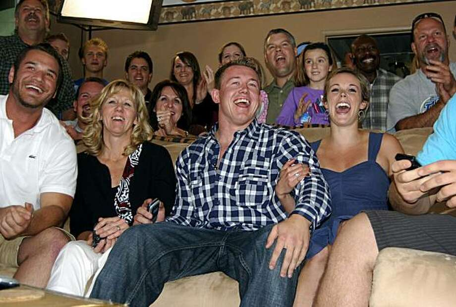 There are smiles all around at the Gerhart household in Norco, Calif., as it is announced on television that Toby Gerhart (center), a Norco High graduate and Stanford All-American, was chosen in the second round of the NFL draft by the Minnesota Vikings. Gerhart's girlfriend, Meredith Ayres, is on the right. From the left, are Gerhart's former Norco teammate Stephen Lindseth and his mother, Lori. Photo: Jerry Soifer, Special To The Chronicle