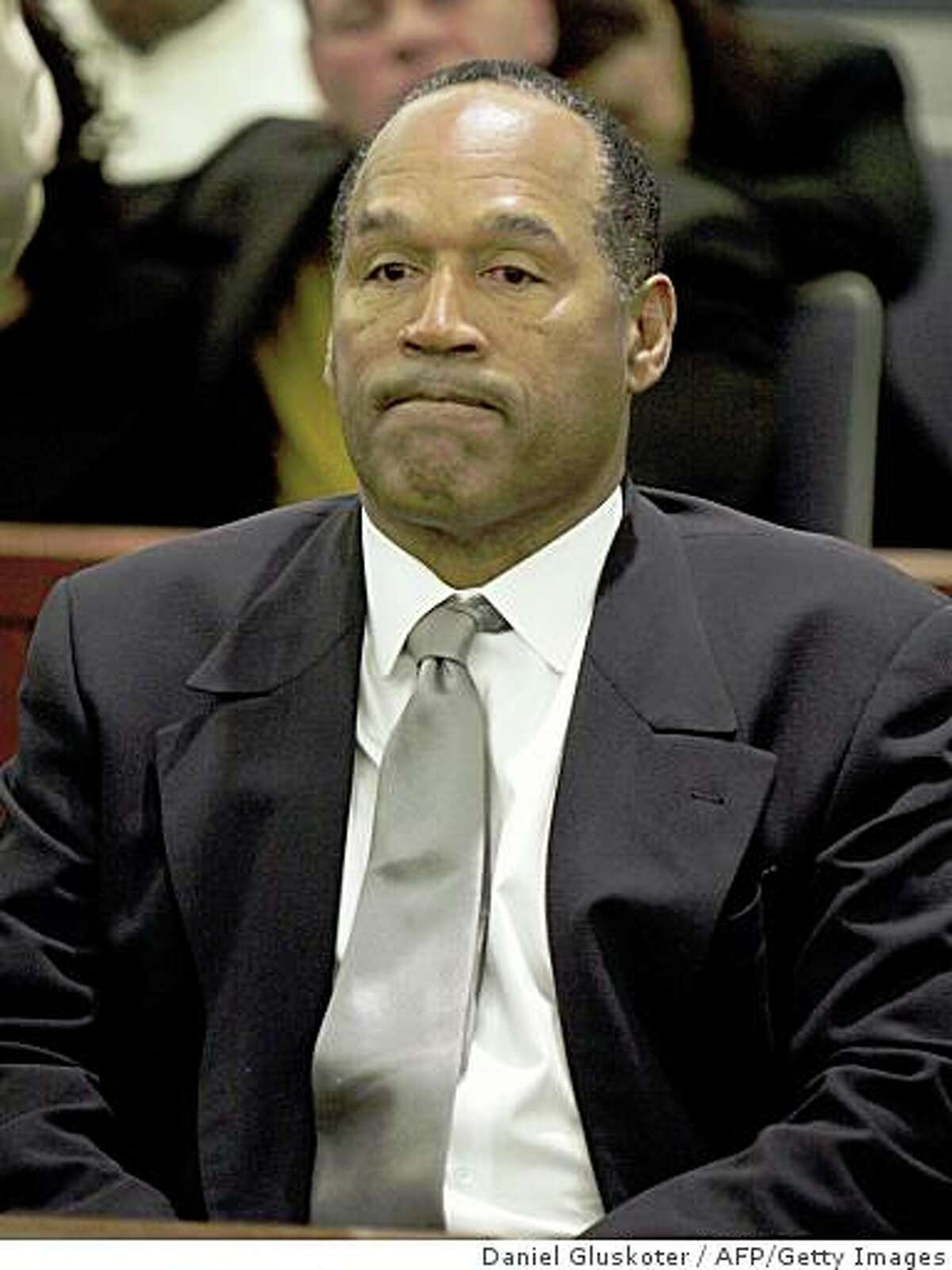 O.J. Simpson reacts as he is found guilty on all 12 charges, including felony kidnapping, armed robbery and conspiracy at the Clark County Regional Justice Center on October 3, 2008 in Las Vegas. Simpson and co-defendant Clarence