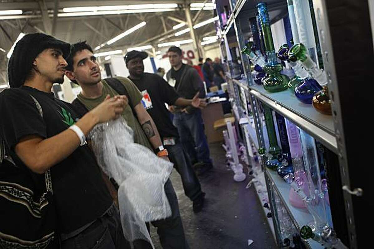 Jonathan Hernandez of South San Francisco (l to r) and Carlos Carvallo of San Francisco look over glass pipes at the Pure Glass booth at the 2010 International Cannabis & Hemp Expo at the Cow Palace in San Francisco, Calif. on Sunday April 18, 2010.