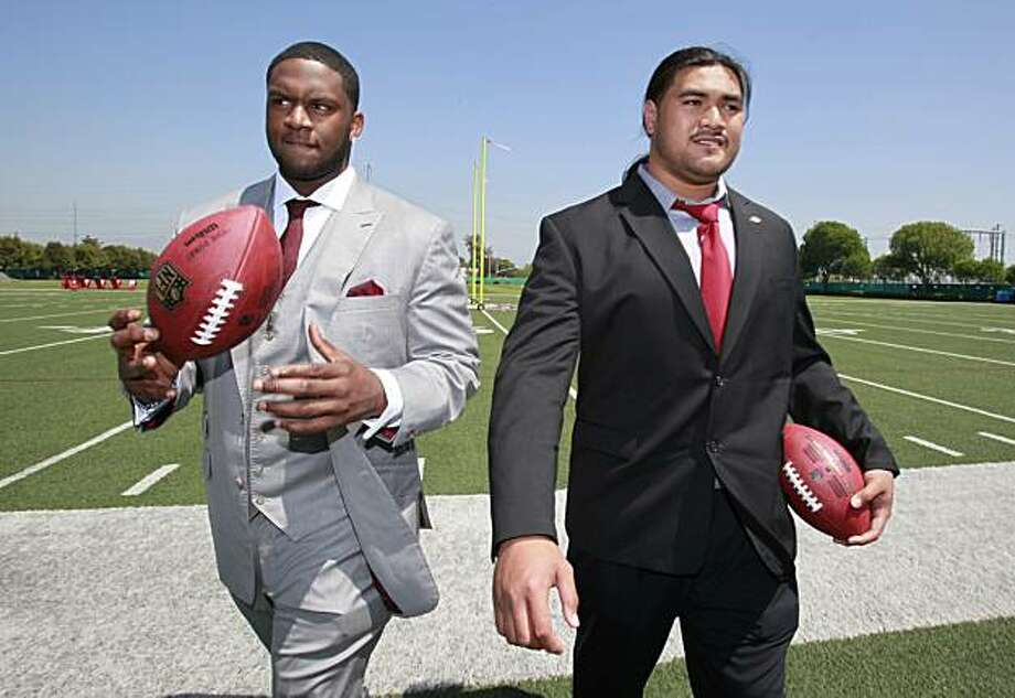 San Francisco 49ers first-round draft picks Mike Iupati, right, a guard from Idaho, and Anthony Davis, left, a tackle from Rutgers, walks off the field after an NFL football news conference at 49ers headquarters in Santa Clara, Calif., Friday, April 23, 2010. Photo: Paul Sakuma, AP