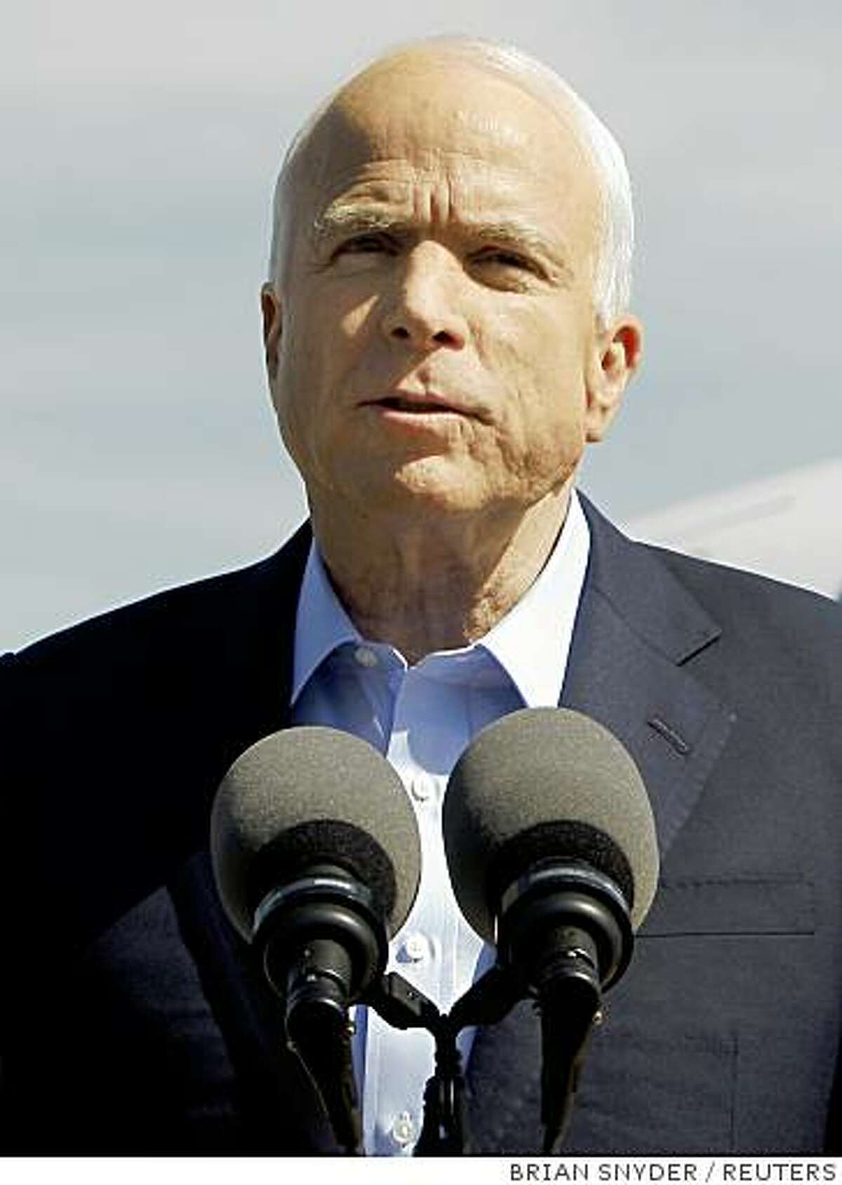 """U.S. Republican presidential nominee Senator John McCain (R-AZ) delivers a statement on the tarmac in Flagstaff, Arizona October 3, 2008 about the passage of the Wall Street bailout bill. """"This rescue bill isn't perfect. It's an outrage that it's even necessary,"""" the Arizona senator told reporters. REUTERS/Brian Snyder (UNITED STATES) US PRESIDENTIAL ELECTION CAMPAIGN 2008 (USA)"""