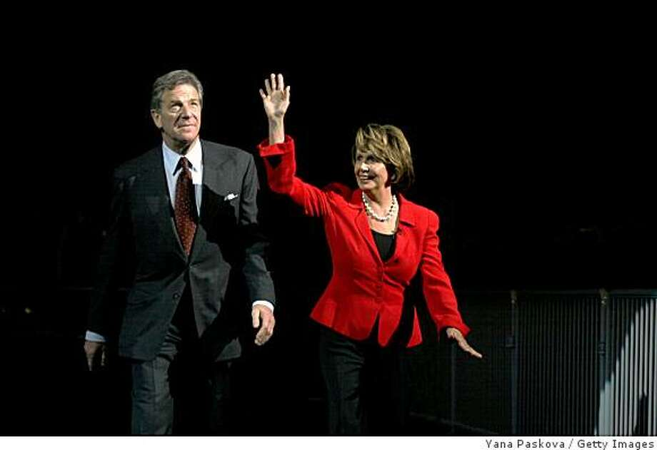 U.S. Speaker of the House Nancy Pelosi (D-CA) and husband Paul Pelosi (L) walk toward the stage during the Jefferson Jackson dinner at the Veterans Memorial Auditorium November 10, 2007 in Des Moines, Iowa. The dinner is an Iowa caucus tradition with more than 9,000 in attendance. Photo: Yana Paskova, Getty Images