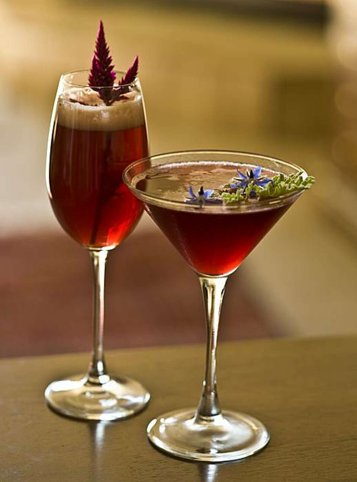 Two cocktail drinks created by Scott Beattie, the Bella Ruffina (left), made with an amaranth spear and the Huck Yu (right), made with scented geranium and borage flower, in Healdsburg, Calif., on September 26, 2008.