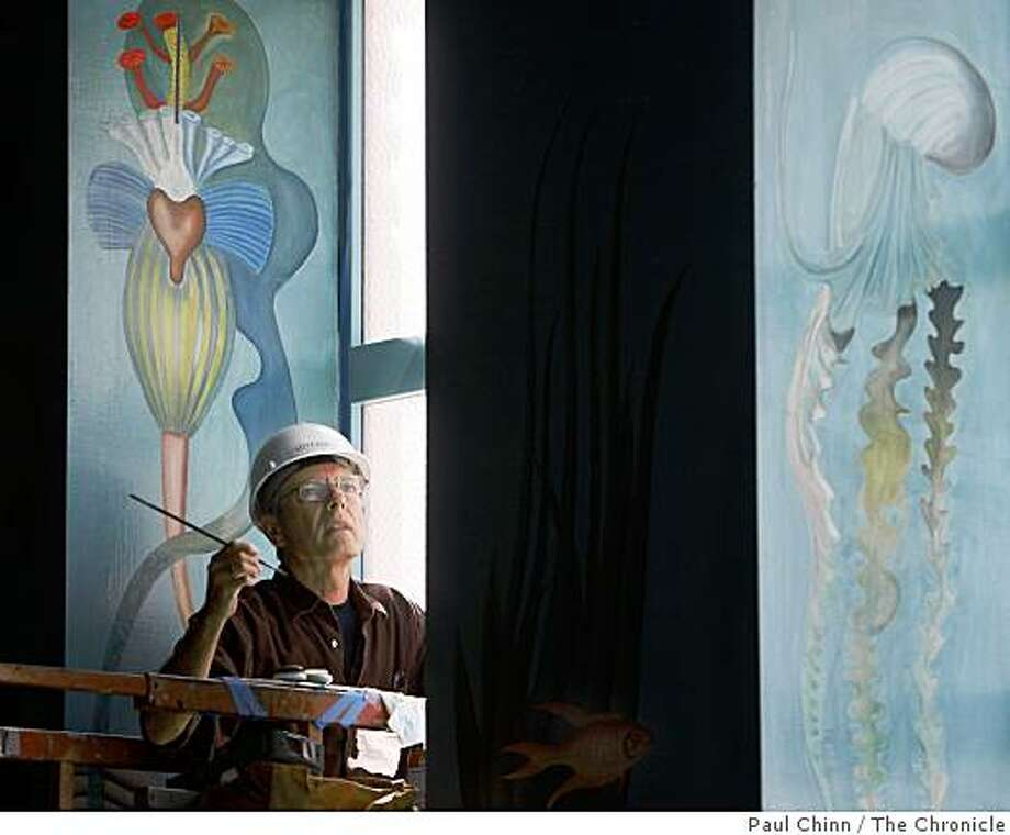 Gregory Thomas restores a mural by artist Hilaire Hiler depicting the underwater world of Atlantis inside the Maritime Museum in San Francisco, Calif. Photo: Paul Chinn, The Chronicle
