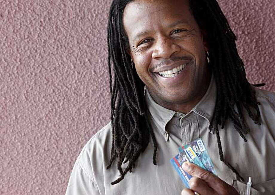 Tyrone Hopper talked about his banking predicament and showed off his new credit cards Wednesday April 21, 2010 near his workplace in San Francisco, Calif. Tyrone Hopper took advantage of the Bank on San Francisco program and got a debit and credit card from a local credit union. Photo: Brant Ward, The Chronicle