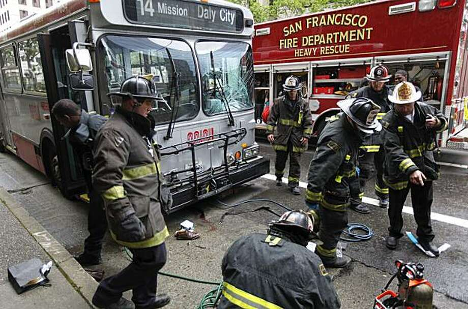San Francisco Fire personnel investigate the scene where a MUNI bus collided with a pedestrian in the East bound lanes of Mission Street just East of Beale Street in the financial district  of San Francisco, Calif. on Wednesday Apr. 21, 2010. Photo: Michael Macor, The Chronicle