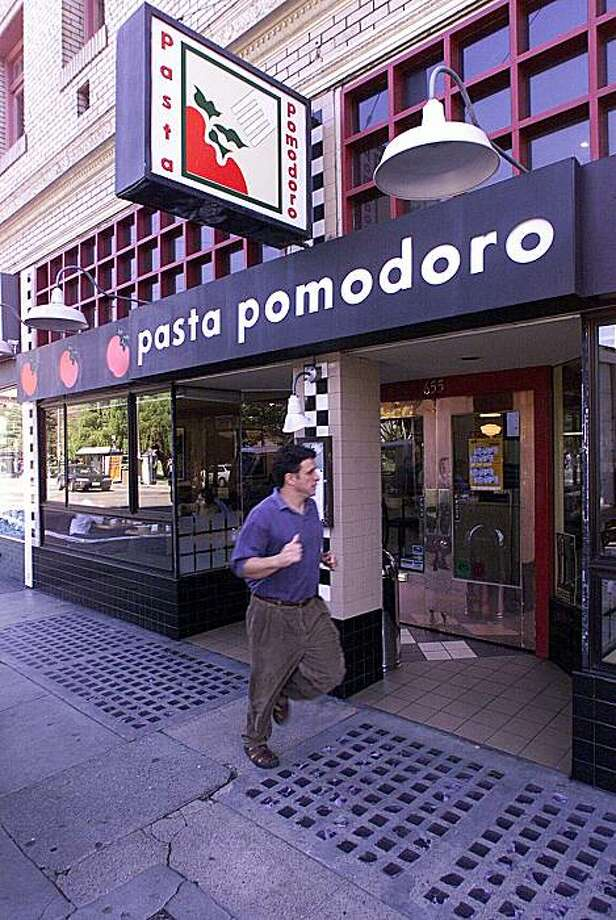 A person jogs in front of Pasta Pomodoro in San Francisco. Photo: Frederic Larson, The Chronicle
