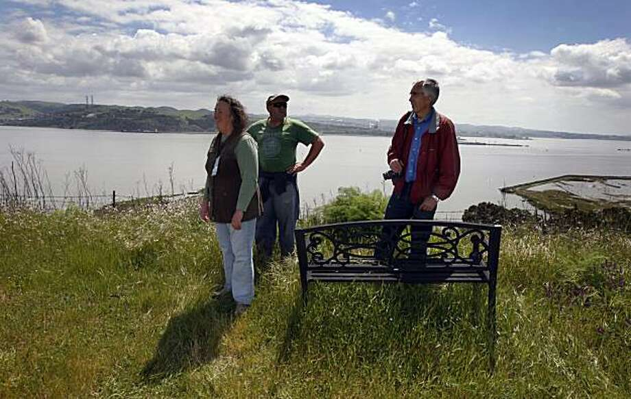 Mare Island Heritage Trust members, Myrna Hayes, Richard Evans and Brian Collett take in the views of San Pablo Bay from a hilltop above the Mare Island historic area that's now a National Park. This area is not funded, presently so the group formed the trust that now has 50 members, with the goal is to keep the place running, which includes a few Victorian homes once naval officers residents, munitions bunkers, hiking trails and the oldest Navy cemetery on the West Coast, Tuesday April 13, 2010. Photo: Lance Iversen, The Chronicle