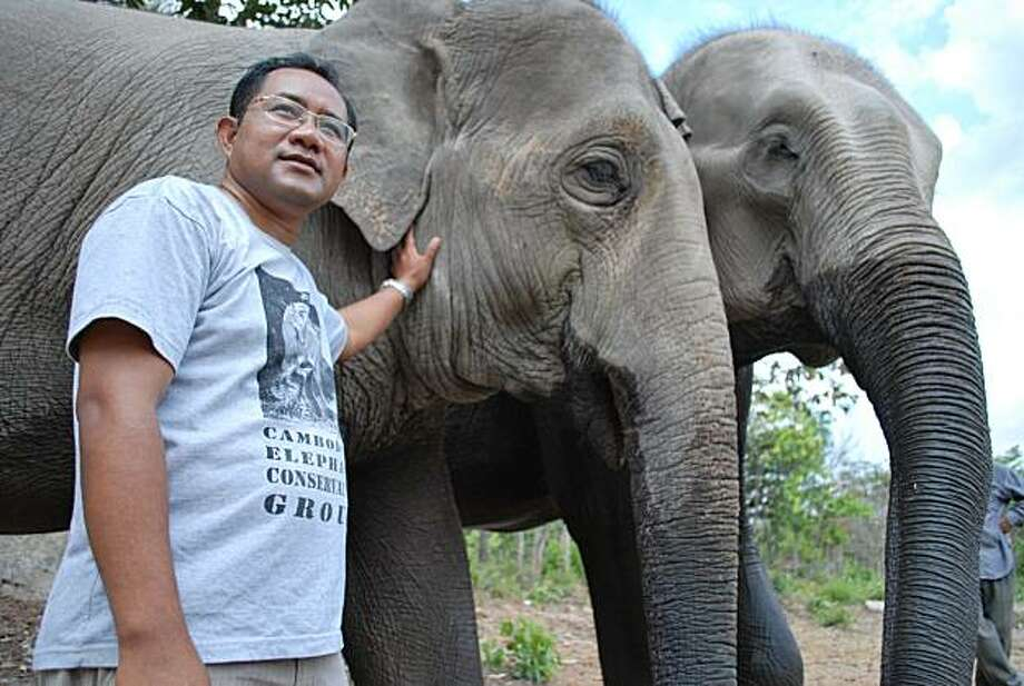 "Sereivathana Tuy cares for elephants at the Phnom Ta Mao zoo in Takeo, a province in southeastern Cambodia. Tuy, a soft-spoken man known among the villagers as ""Uncle Elephant"", will be awarded the 2010 Goldman Environmental Prize, for his efforts of finding a more peaceful way of living with animals. Photo: Courtesy, Geoffrey Cain"