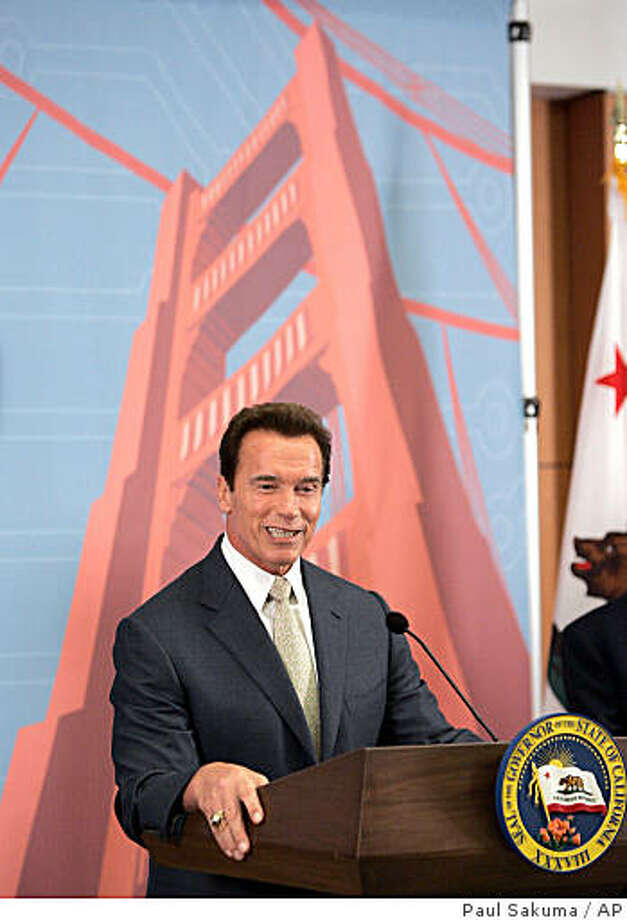 Calif. Gov. Arnold Schwarzenegger announces that California will be the first state to be the official partner of the CeBIT trade fair, at Intel Corp. headquarters in Santa Clara, Calif., Thursday, Oct. 2, 2008. CeBIT is one the largest trade fairs for digital business solutions and communications technology. In background is an artist drawing of the Golden Gate Bridge. (AP Photo/Paul Sakuma) Photo: Paul Sakuma, AP