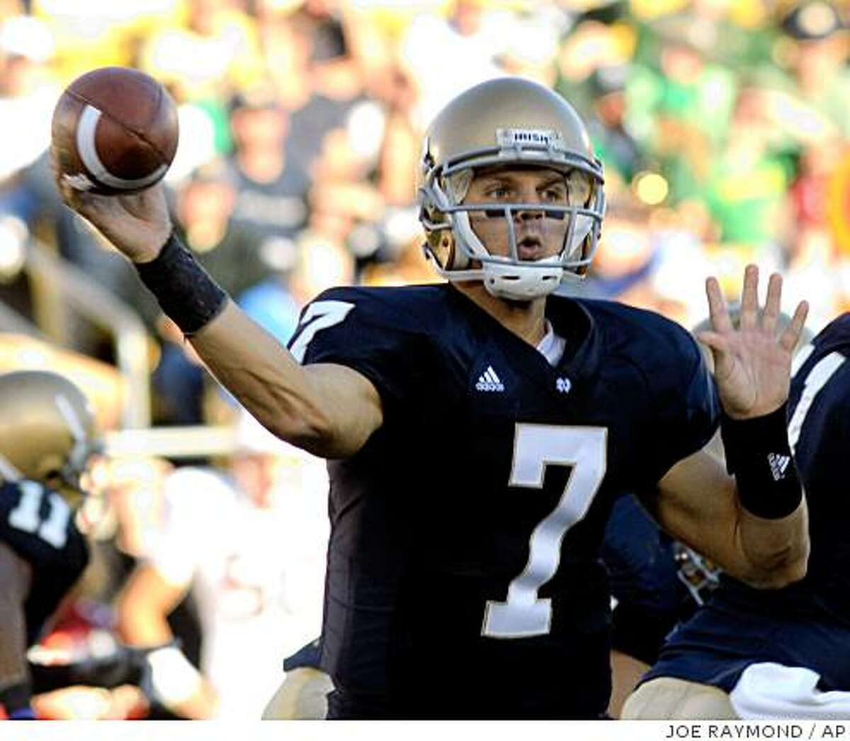 Notre Dame quarterback Jimmy Clausen throws a pass in fourth-quarter action in an NCAA college football game Saturday, Oct. 4, 2008, in South Bend, Ind. Notre Dame defeated Stanford 28-21. (AP Photo/Joe Raymond)