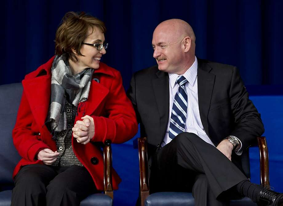 Former Arizona Rep. Gabrielle Giffords and her husband Mark Kelly, attend the unveiling of the USS Gabrielle Giffords at the Pentagon, Friday, Feb. 10, 2012. The Navy has named a ship for Gabrielle Giffords, the recently retired congresswoman from Arizona who is recovering from a gunshot wound to the head received in January 2011. Photo: Manuel Balce Ceneta, Associated Press