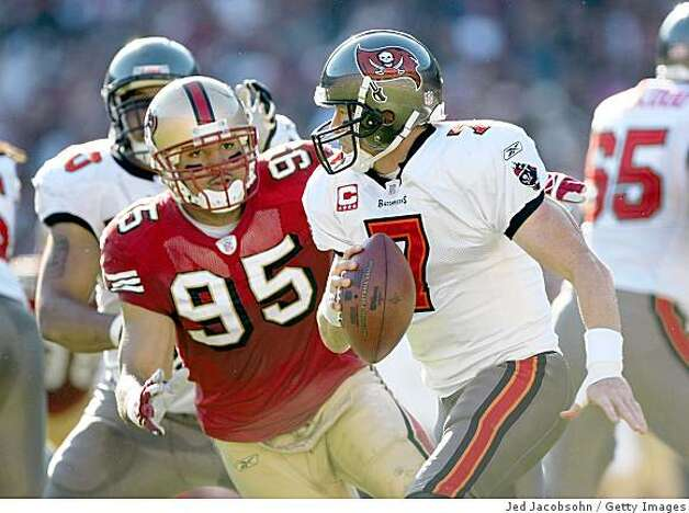 SAN FRANCISCO - DECEMBER 23:  Jeff Garcia #7 of the Tampa Bay Buccaneers tries to avoid Tully Banta -Cain #95 of the San Francisco 49ers at Monster Park on December 23, 2007 in San Francisco, California. (Photo by Jed Jacobsohn/Getty Images) Photo: Jed Jacobsohn, Getty Images