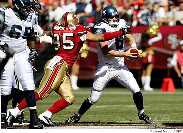 49ers_seahawks_080_mac.jpg Seattle Seahawks quarterback Matt Hasselbeck (8) under pressure from San Francisco 49ers Tully Banta-Cain (95) in the first quarter. The San Francisco 49ers vs. the Seattle Seahawks. Photographed in, San Francisco, Ca, on 9/30/07. Photo by: Michael Macor/ The Chronicle Photo: Michael Macor, SFC
