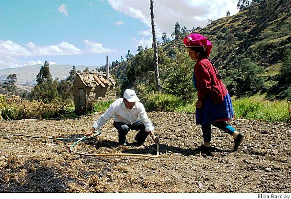 Gregorio Huanuco and his wife Gregoria set up a sprinkler system to irrigate their potato field. Global climate change has shortened the rainy season in the Peruvian Andes, forcing farmers to come up with new irrigation strategies.
