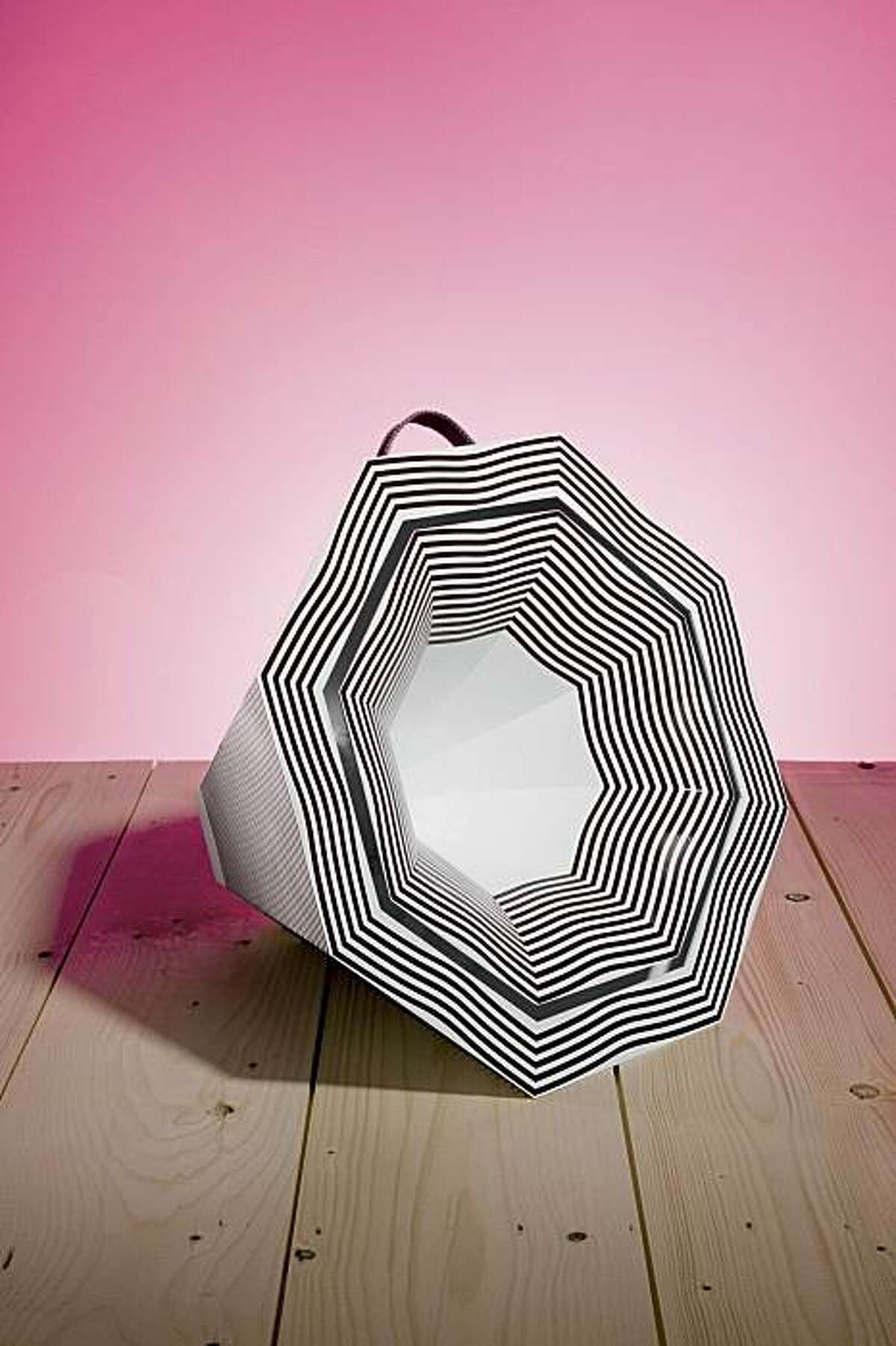 A loudspeaker is shaped to incorporate graphic lines of solar cells.