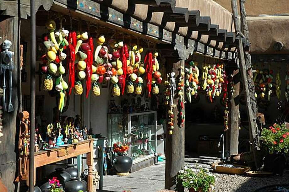 Ceramic fruit and chilies hang across the front of a store in Santa Fe. Photo: Bill Fink, Special To The Chronicle