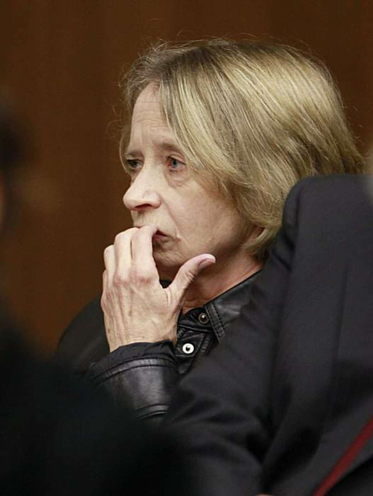 Former longtime San Francisco lab technician Deborah Madden appears for her arraignment for drug possession in a South San Francisco, Calif., courtroom, Monday, April 5, 2010. The San Francisco police crime lab was shut March 9, 2010 amid allegations in December that Madden stole cocaine evidence. Madden was in court on Monday on an unrelated charge to the lab scandal. The district attorney's office has already thrown out or not charged 550 cases because of possible evidence tampering, and is reviewing about 1,400 more for possible dismissal.
