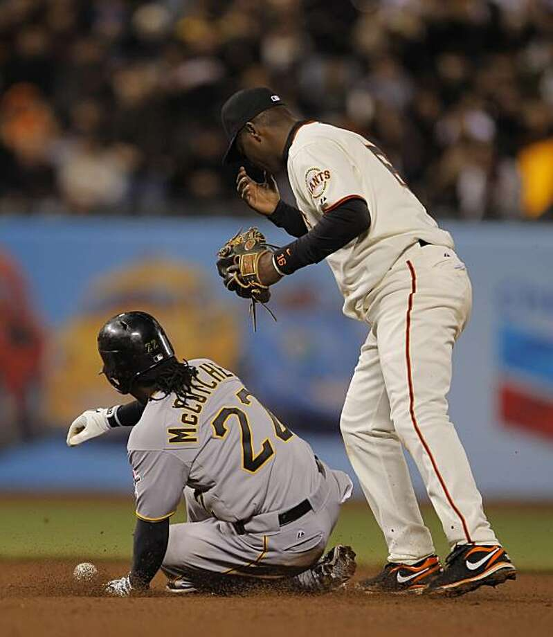 Edgar Renteria drops a double play ball in the top of the eighth inning. The San Francisco Giants played the Pittsburgh Pirates at AT&T Park in San Francisco, Calif., on Tuesday, April 12, 2010. Photo: Carlos Avila Gonzalez, The Chronicle
