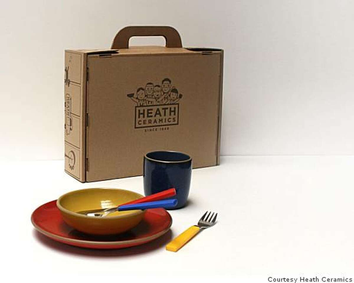 Heath kids set with red yellow and blue plate, cup and bowl and new flatware designed by David Mellor.