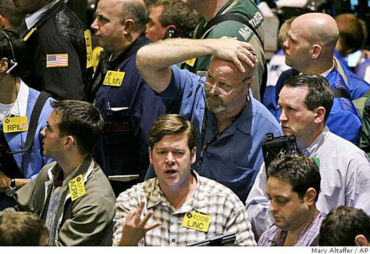 Traders work the crude oil options pit at the New York Mercantile Exchange, Tuesday, Sept. 30, 2008 in New York. Oil prices swung higher Tuesday, recovering from the previous day's plunge as edgy investors trickled back into the market on hopes that Congress would resurrect a failed U.S. financial bailout plan. (AP Photo/Mary Altaffer)