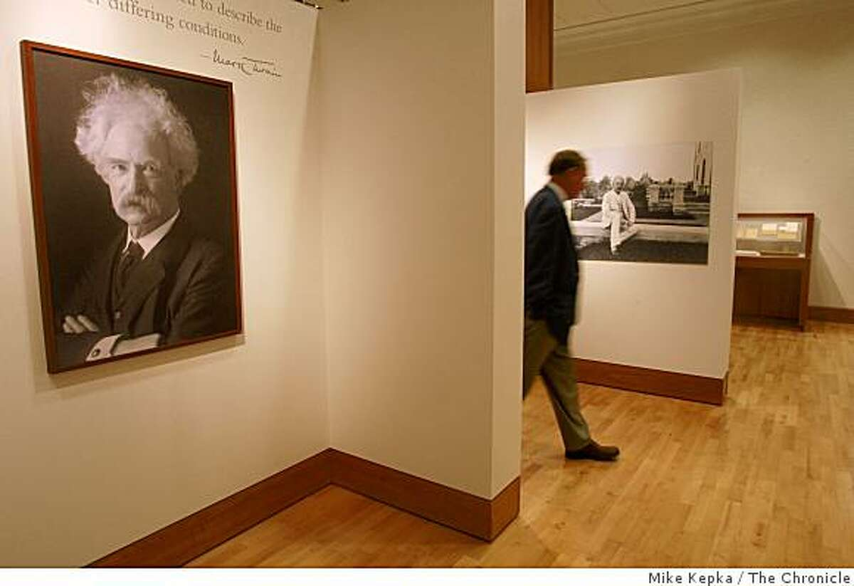 """Anthony Bliss, curator of Rare books at the Bancroft Library, walks through the """"Mark Twain at Play"""" exhibit at U.C. Berkeley's new Bancroft Library on Wednesday Oct. 01, 2008 in San Francisco Calf. The exhibit, which doesn't officially open till December, will be open for a one day sneak preview this Friday."""