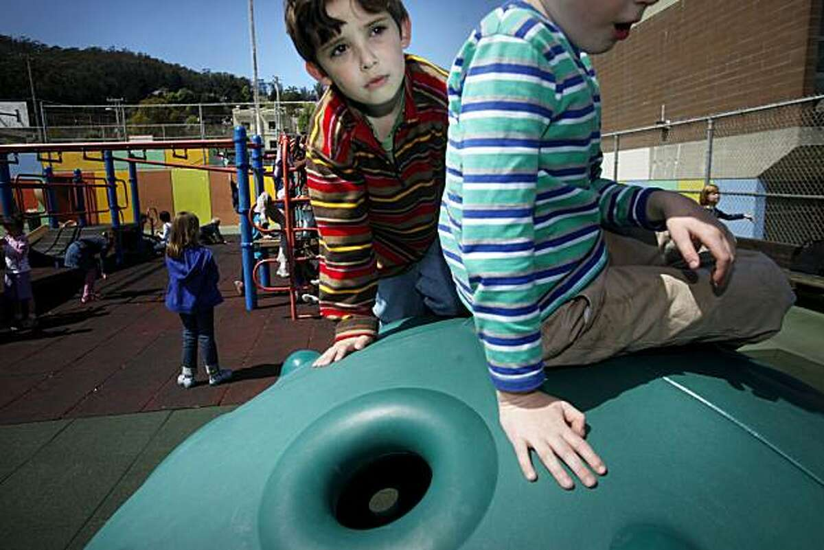 Grattan Elementary kindergartner, Julian Kanter, 6, plays with other students on top of newly added play structure at their playground on Tuesday April 13 2010 in San Francisco, Calif. The equipment is designed to help students with autism have and easier time meshing with other students on the playground.