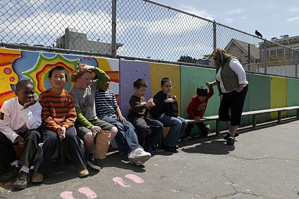 A group of students in the Grattan Elementary School Special Day program for autistic children sit quietly before heading to their classroom on Tuesday April 13 2010 in San Francisco, Calif. The school has at least 28 students with autism and tries to incorporate their presence into a normal part of daily life on campus.