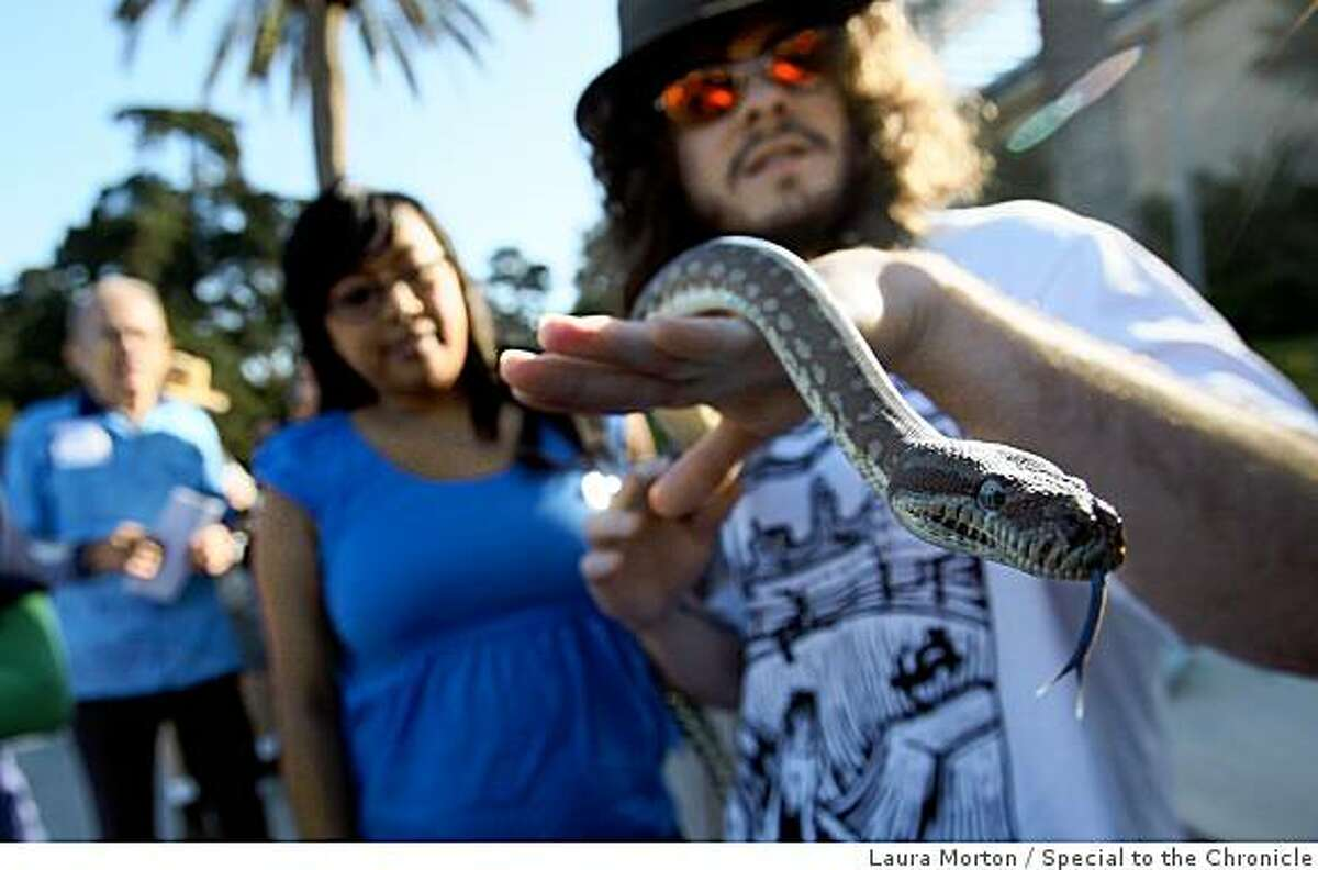 Rusty, a python, was on hand to entertain the crowd waiting in line to visit the California Academy of Sciences during the museum's opening day in San Francisco, Calif., on Saturday, September 27, 2008