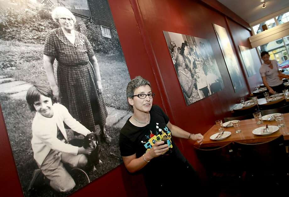 Sharon Ardiana, the owner of Gialina, stands by a picture of herself and her grandmother. Photo: Brant Ward, The Chronicle